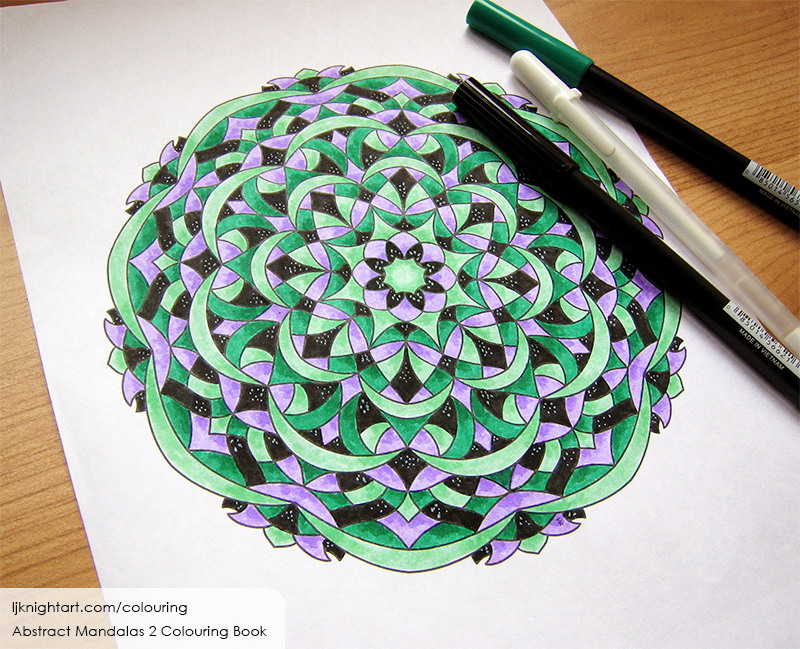 Coloured mandala colouring page in purple, black and green