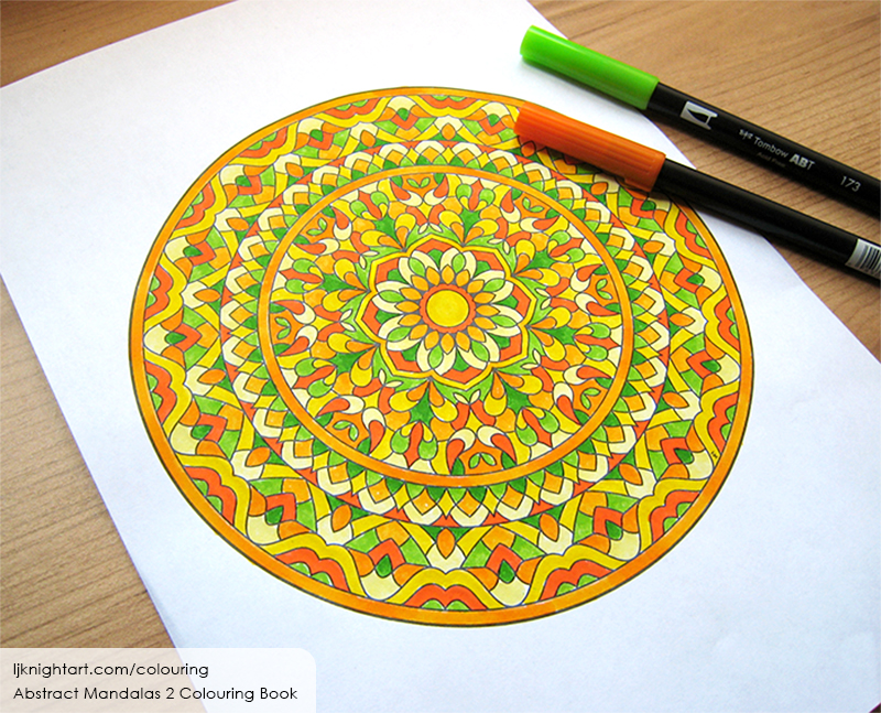 Coloured mandala colouring page in yellow, orange and green
