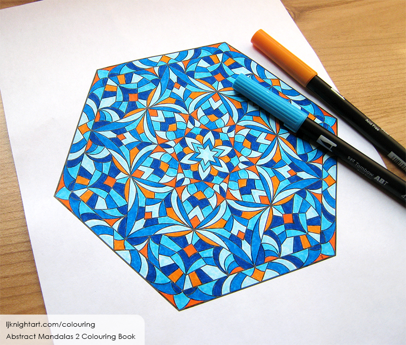 Coloured hexagon mandala colouring page in blue and orange