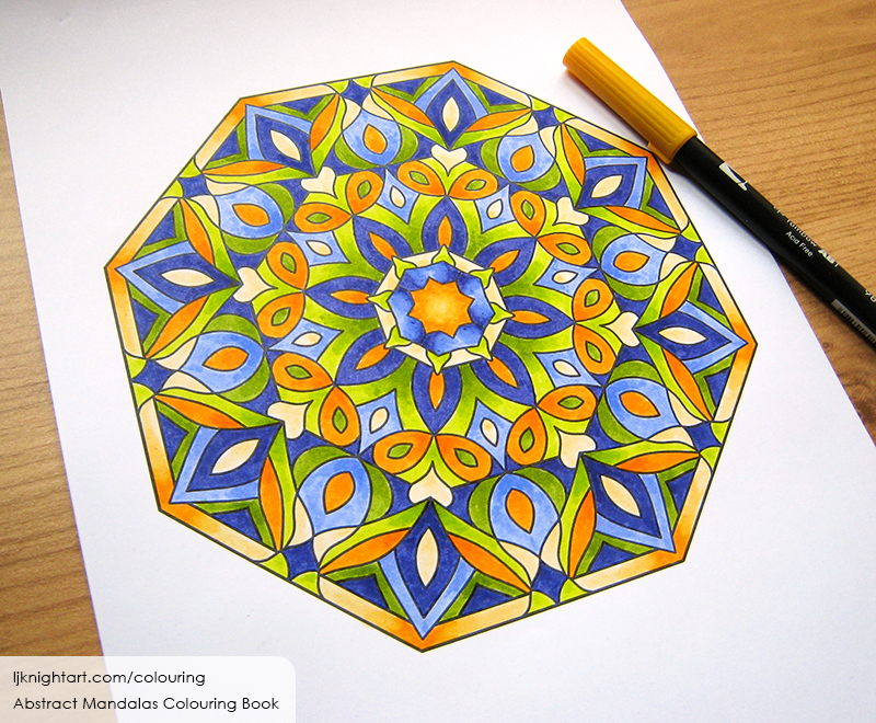 Blue and orange mandala colouring page