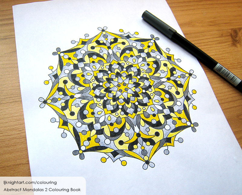 Coloured black and yellow mandala colouring page for adults