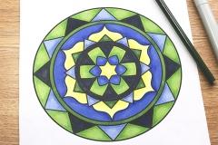 Coloured mandala colouring page